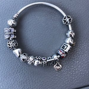 Authentic silver pandora bangle with charms